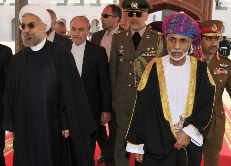 Sultan Qaboos, second right, receives Iranian president Hassan Rouhani, left, at Al Alalam Palace in Muscat, Oman, Wednesday, March 12, 2014. Rouhani is in Oman for a two day visit. (AP Photo/Abo Zayed)