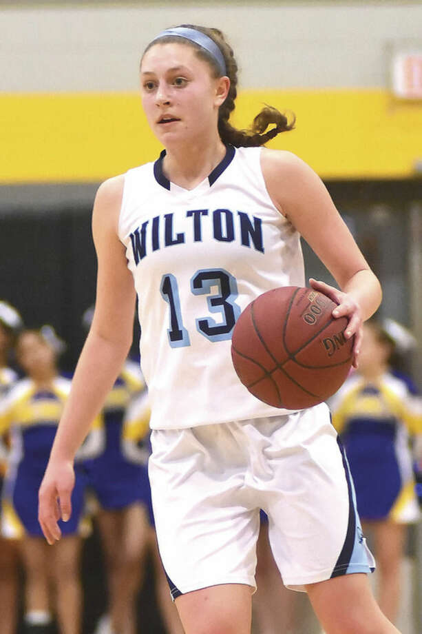 Hour photo/John Nash - Action from Monday's CIAC Class LL girls basketball semifinals between Wilton and Mercy.