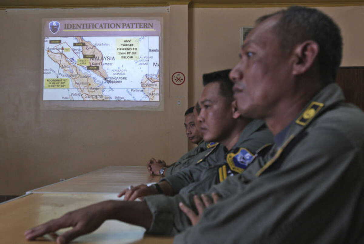 An operation map is displayed on the wall as Indonesian Air Force personnel listen to a briefing following to a search mission for the missing Malaysia Airlines Boeing 777 that was conducted over the Strait of Malacca, at Suwondo air base in Medan, North Sumatra, Indonesia, Wednesday, March 12, 2014. Malaysia asked India to join the expanding search for the missing jetliner near the Andaman Sea, far to the northwest of its last reported position and a further sign Wednesday that authorities have no idea where the plane might be more than four days after it vanished. (AP Photo/Binsar Bakkara)