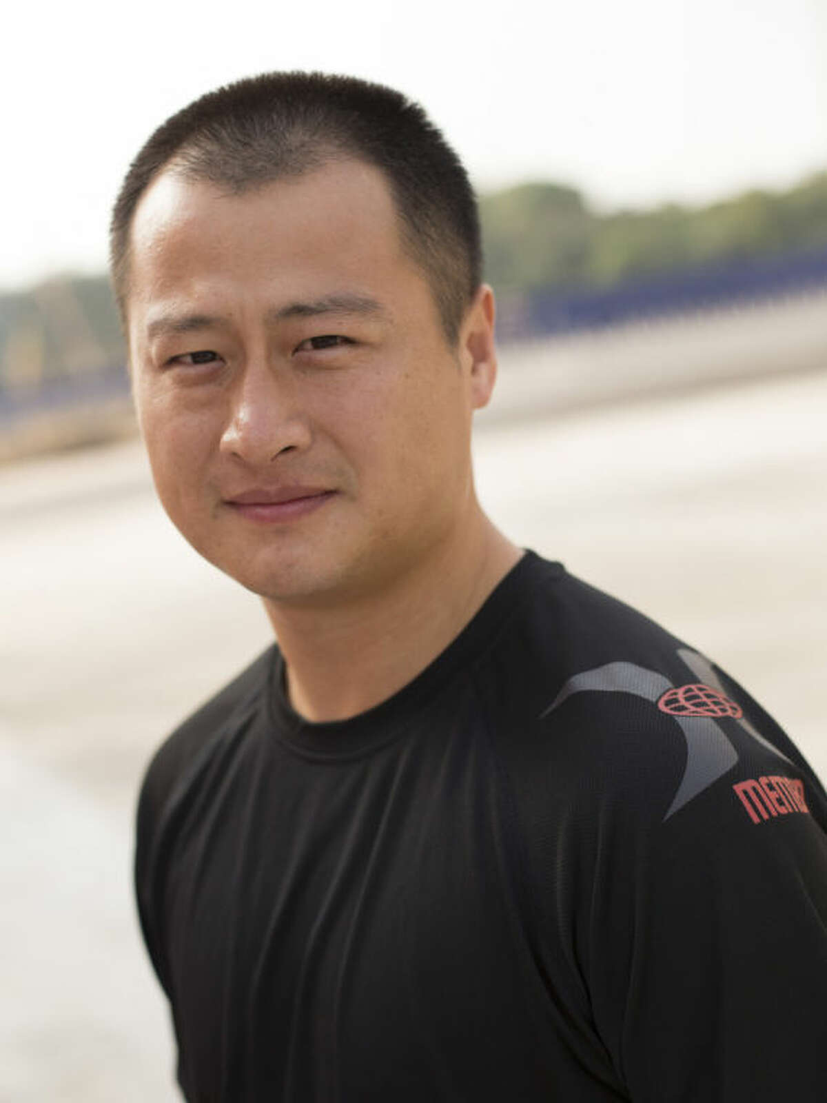 """This undated photo provided by Brian Ho, shows stunt man Ju Kun on the back lot of the new Pinewood Studios in Johor Bahru, Malaysia. Ju Kun, whose credits include the acclaimed martial arts epic """"The Grandmaster,"""" was among the passengers on the Malaysia Airlines plane that disappeared early Saturday, March 8, 2014. Ju Kun was scheduled to work on the series pilot for ?""""Marco Polo,?"""" a joint Weinstein Co. and Netflix production, at the studio in Malaysia before he boarded the flight to return home to Beijing. (AP Photo/Brian Ho) NO SALES, NO ARCHIVES, MANDATORY CREDIT, ONE TIME USE ONLY"""