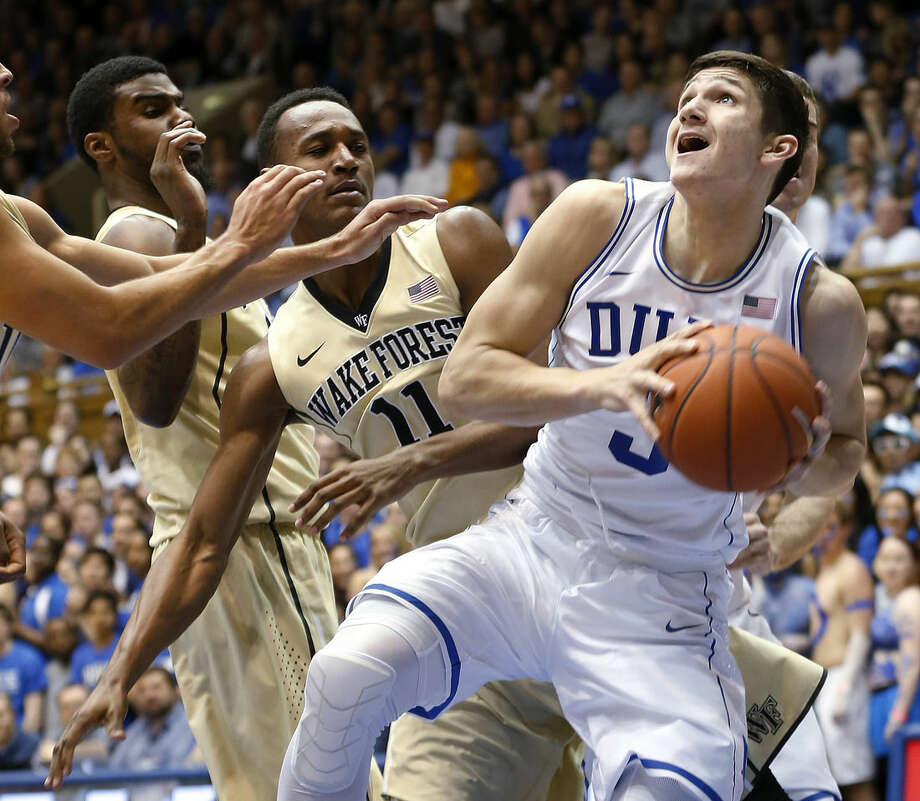 FILE - In this March 4, 2015, file photo, Duke's Grayson Allen (3) looks to go to the basket against Wake Forest's Darius Leonard, left rear, and Greg McClinton (11) during the first half of an NCAA college basketball game in Durham, N.C. The four freshmen on this year's top-seeded Blue Devils (29-4) squad are eager to create their own postseason legacy when they make their NCAA Tournament debuts on Friday night in Charlotte in South Region play against the winner of the North Florida-Robert Morris matchup. (AP Photo/Ellen Ozier, File)