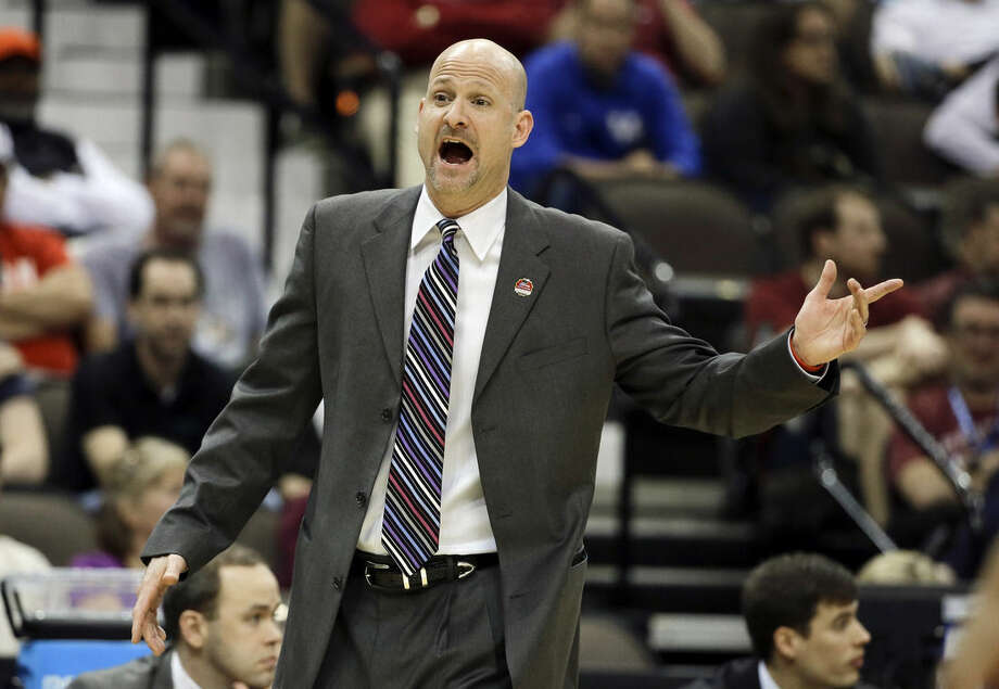 Mississippi head coach Adam Kennedy directs players during the first half of an NCAA tournament second round college basketball game against Xavier, Thursday, March 19, 2015, in Jacksonville, Fla. (AP Photo/Chris O'Meara)
