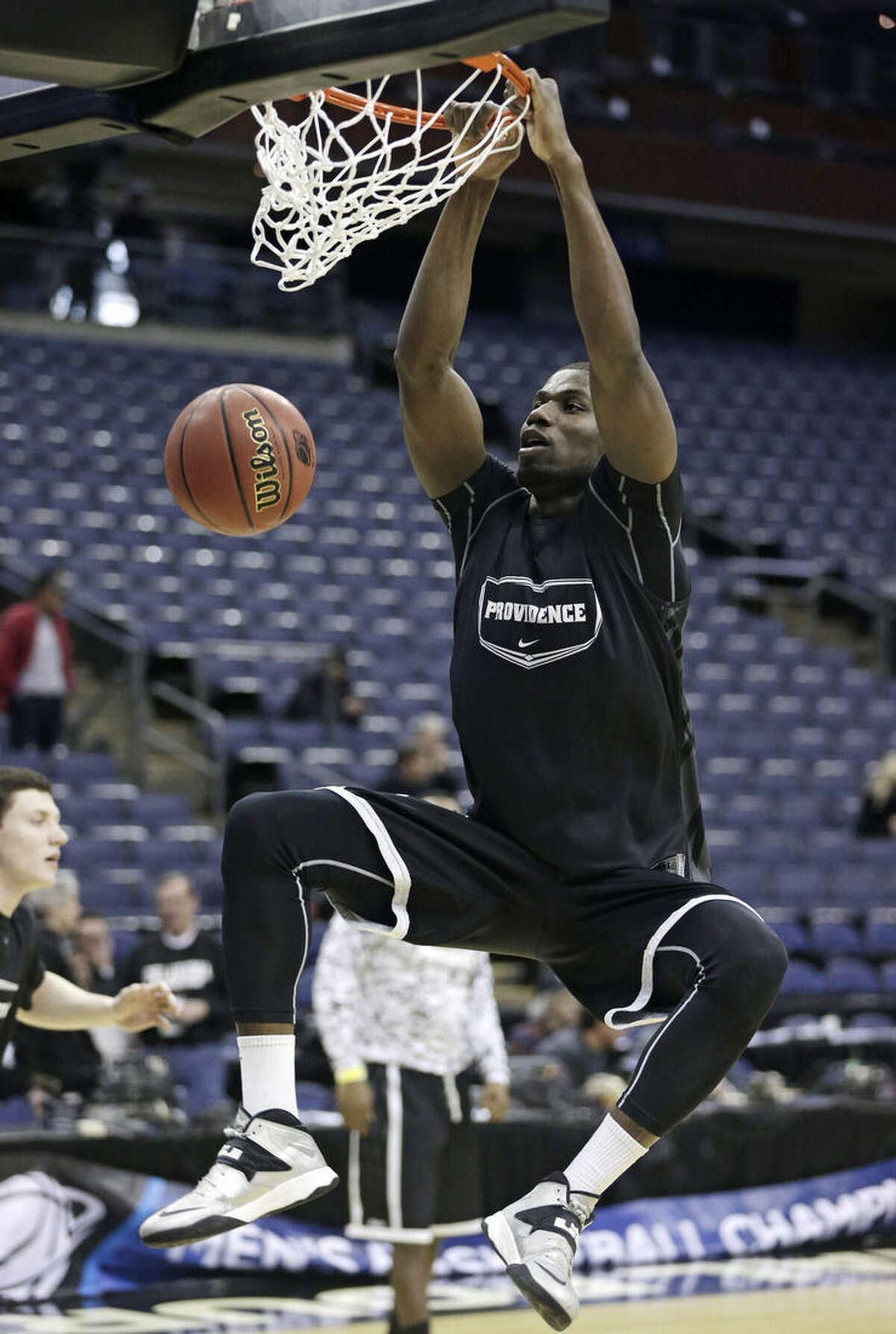 Providence's Ben Bentil dunks during practice at the NCAA college basketball tournament in Columbus, Ohio, Thursday, March 19, 2015. Providence plays Dayton in the second round on Friday. (AP Photo/Tony Dejak)