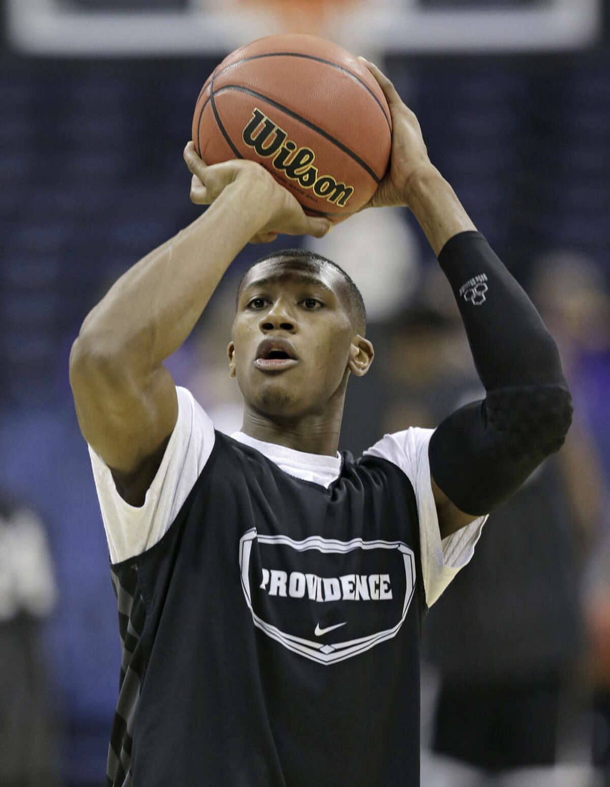 Providence's Kris Dunn shoots during practice at the NCAA college basketball tournament in Columbus, Ohio, Thursday, March 19, 2015. Providence plays Dayton in the second round on Friday. (AP Photo/Tony Dejak)