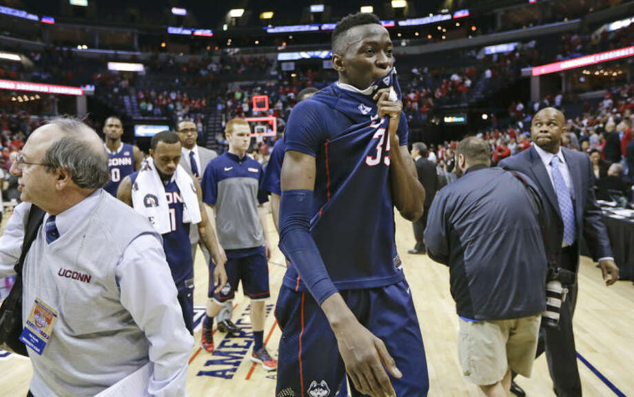 Connecticut center Amida Brimah (35) leaves the court following an NCAA college basketball game against Louisville in the final of the American Athletic Conference men's tournament Saturday, March 15, 2014, in Memphis, Tenn. Louisville won 71-61. (AP Photo/Mark Humphrey)