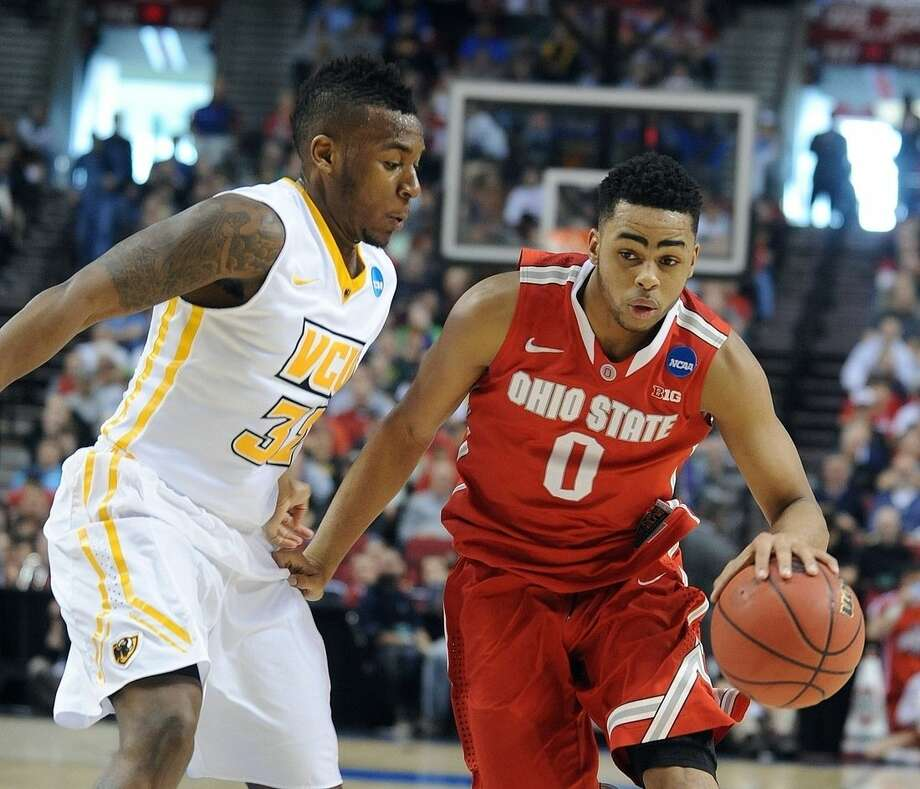 Ohio State guard D'Angelo Russell, right, drives on Virginia Commonwealth guard Melvin Johnson during the first half of an NCAA college basketball second-round game in Portland, Ore., Thursday, March 19, 2015. (AP Photo/Greg Wahl-Stephens)