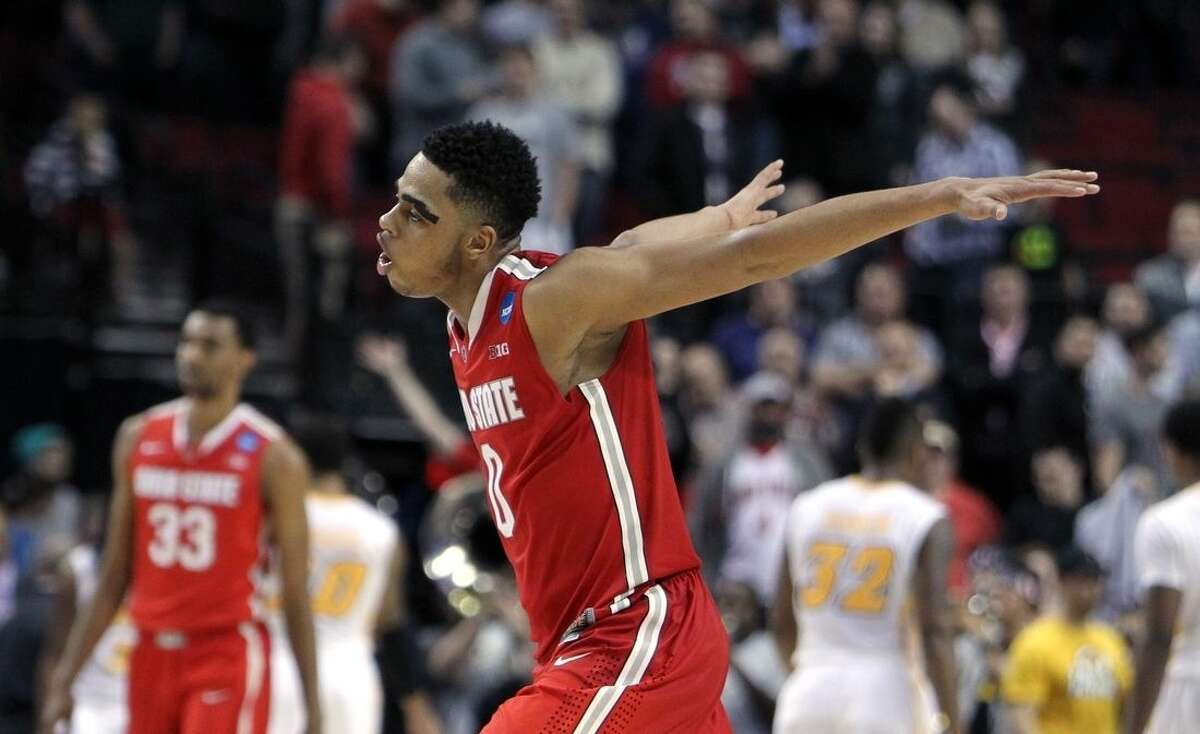 Ohio State guard D'Angelo Russell races toward his teammates after the buzzer in overtime in an NCAA college basketball second-round game against Virginia Commonwealth in Portland, Ore., Thursday, March 19, 2015. Ohio State won 75-72. (AP Photo/Craig Mitchelldyer)