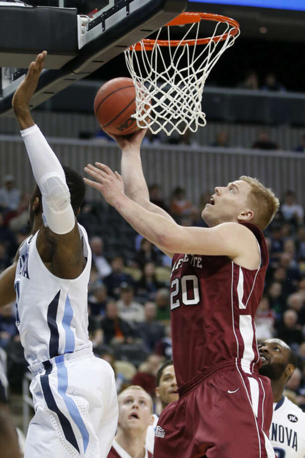 Lafayette's Dan Trist (20) shoots past Villanova's Dylan Ennis, left, during the first half of an NCAA tournament second round college basketball game, Thursday, March 19, 2015, in Pittsburgh. (AP Photo/Gene J. Puskar)