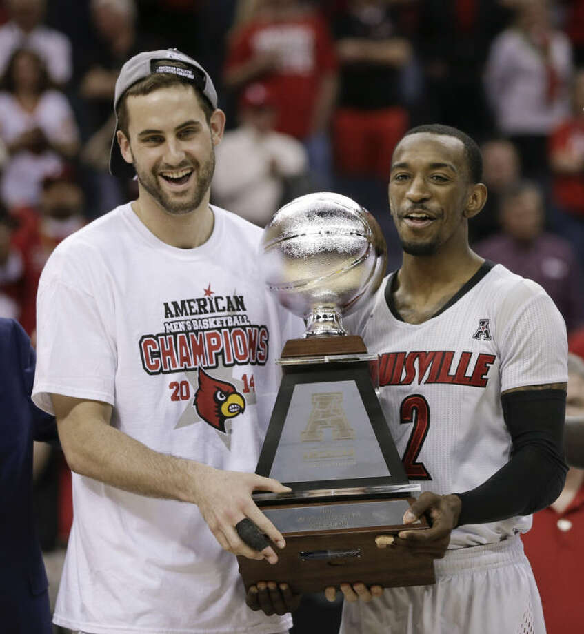 Louisville forward Luke Hancock, left, and guard Russ Smith (2) hold the championship trophy following an NCAA college basketball game against Connecticut in the final of the American Athletic Conference men's tournament Saturday, March 15, 2014, in Memphis, Tenn. Louisville won 71-61. (AP Photo/Mark Humphrey)