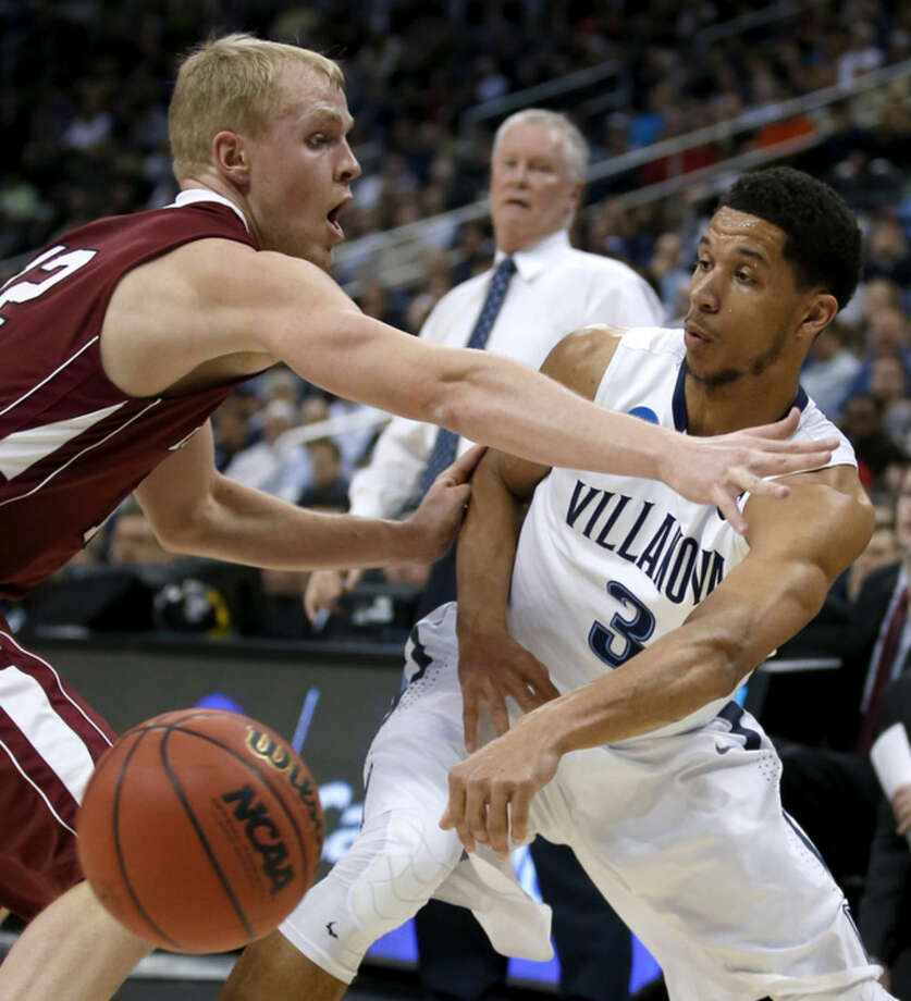 Villanova's Josh Hart (3) passes around Lafayette's Seth Hinrichs (12) during the first half of an NCAA tournament second-round college basketball game, Thursday, March 19, 2015, in Pittsburgh. (AP Photo/Gene J. Puskar)