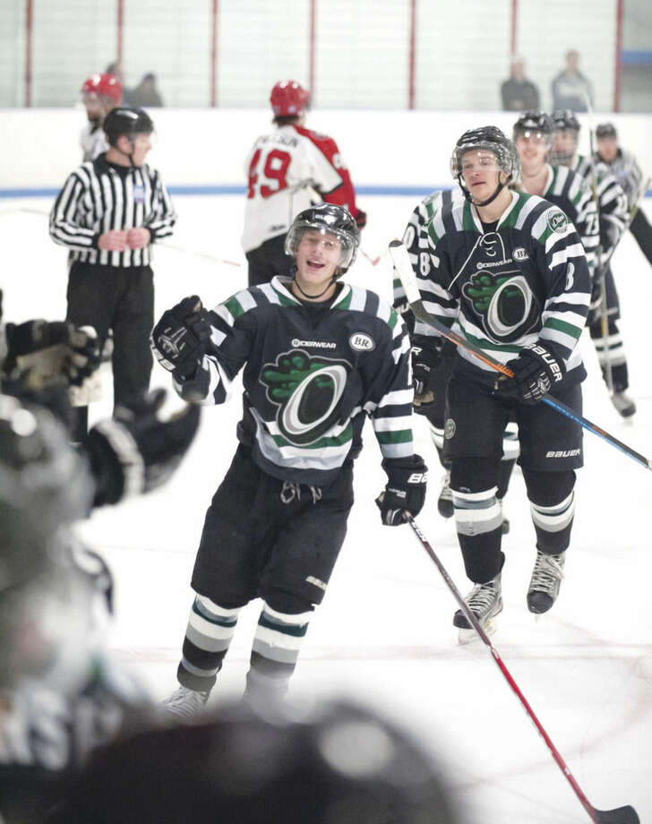 Hour photo/Josh GibneyConnecticut's Todd Jackson, center, celebrates his goal during the first period of Thursday's EHL championship final series game at Cyclones Arena in Hudson, N.H..
