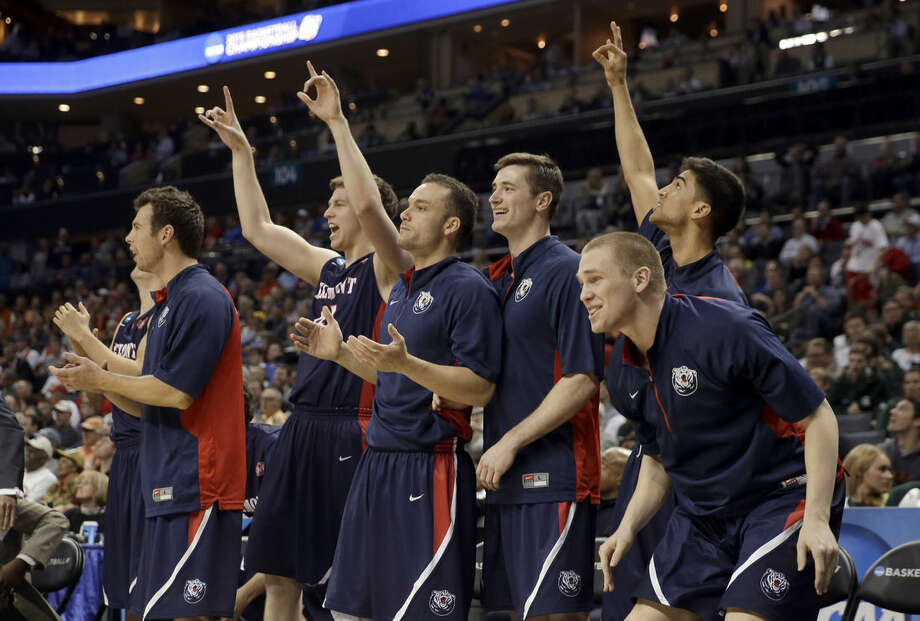Belmont players react on the bench to a teammate's basket against Virginia during the first half of an NCAA tournament college basketball game in the Round of 64 in Charlotte, N.C., Friday, March 20, 2015. (AP Photo/Gerald Herbert)