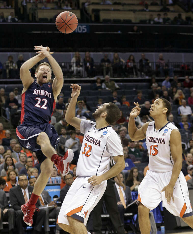 Belmont's Reece Chamberlain (22) loses the ball as he drives against Virginia's London Perrantes (32) and Malcolm Brogdon (15) during the first half of an NCAA tournament college basketball game in the Round of 64 in Charlotte, N.C., Friday, March 20, 2015. (AP Photo/Nell Redmond)