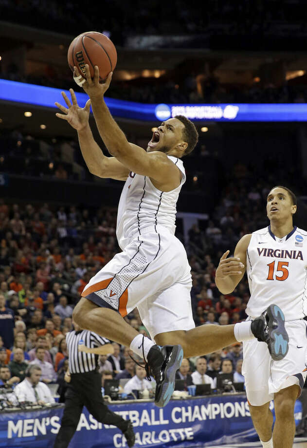 Virginia's Justin Anderson drives to the basket against Belmont during the first half of an NCAA tournament college basketball game in the Round of 64 in Charlotte, N.C., Friday, March 20, 2015. (AP Photo/Gerald Herbert)
