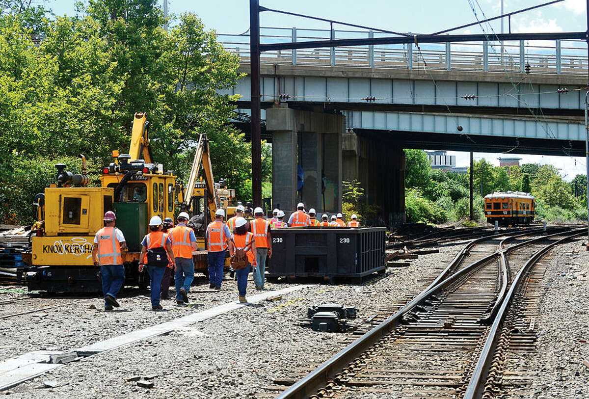 Hour photo / Erik Trautmann Officials with the engineering firm HNTB Corp and Metro North Railroad inspect Metro-North's Danbury Line near Science Rd and Crescent St Thursday. The State Bond Commission last month appproved $4 million for project and Norwalk's legislative delegation in Hartford on Wednesday asked U.S. Department of Transportation secretary to support Connecticut's request for $12 million in federal funds for the project.