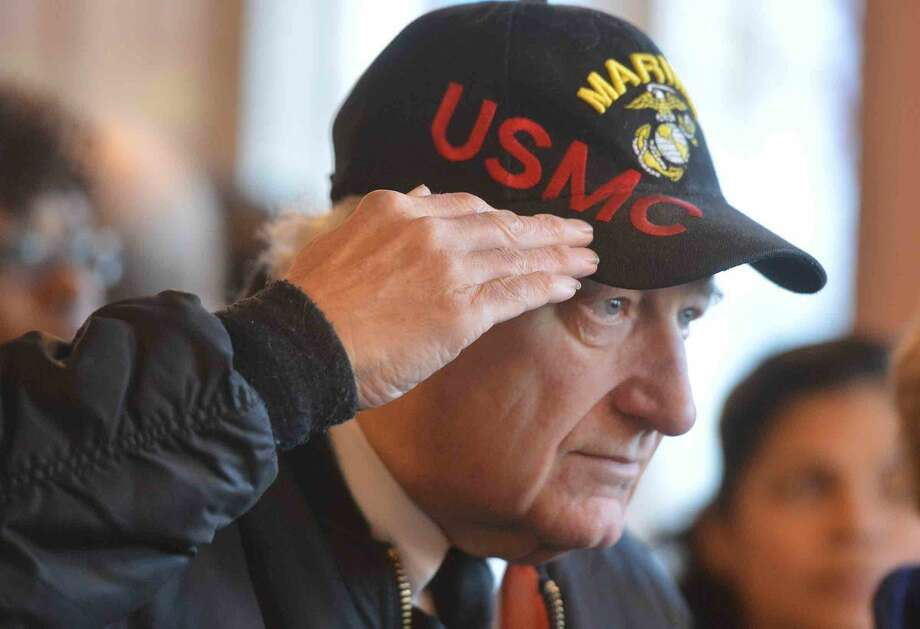 Hour Photo/Alex von Kleydorff United States Marine Corps Vietnam Veteran Ed Downing salutes the flag during The Pledge of Allegiance at the City's Pearl Harbor Remembrance Day event at Norwalk City Hall
