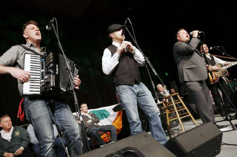 Dropkick Murphys perform during the annual St. Patrick's Day Breakfast in Boston, Sunday, March 16, 2014. (AP Photo/Michael Dwyer)