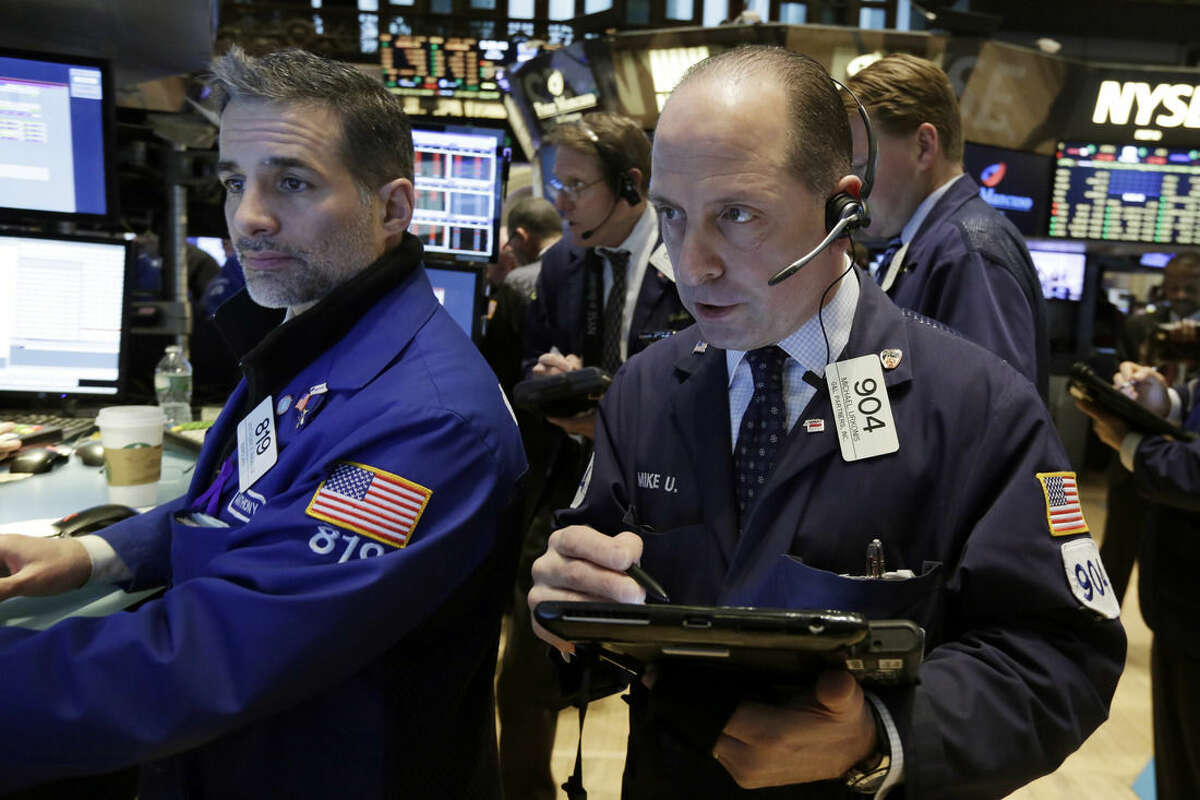 Specialist Anthony Rinaldi, left, and trader Michael Urkonis work on the floor of the New York Stock Exchange, Friday, March 20, 2015. Stocks are moving higher in early trading as investors respond to some surprisingly strong earnings from U.S. companies. (AP Photo/Richard Drew)