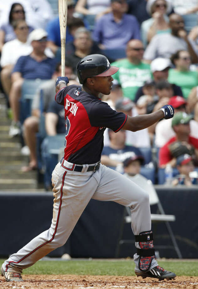 Atlanta Braves' B.J. Upton hits a fifth-inning RBI-single off Atlanta Braves relief pitcher Atahualpa Severino in a spring exhibition baseball game in Tampa, Fla., Sunday, March 16, 2014. (AP Photo/Kathy Willens)