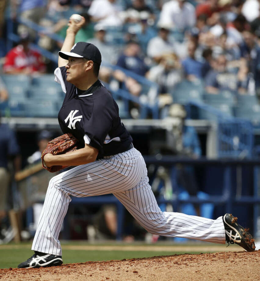 New York Yankees starting pitcher Masahiro Tanaka delivers in the fourth inning against the Atlanta Braves in a spring exhibition baseball game in Tampa, Fla., Sunday, March 16, 2014. (AP Photo/Kathy Willens)