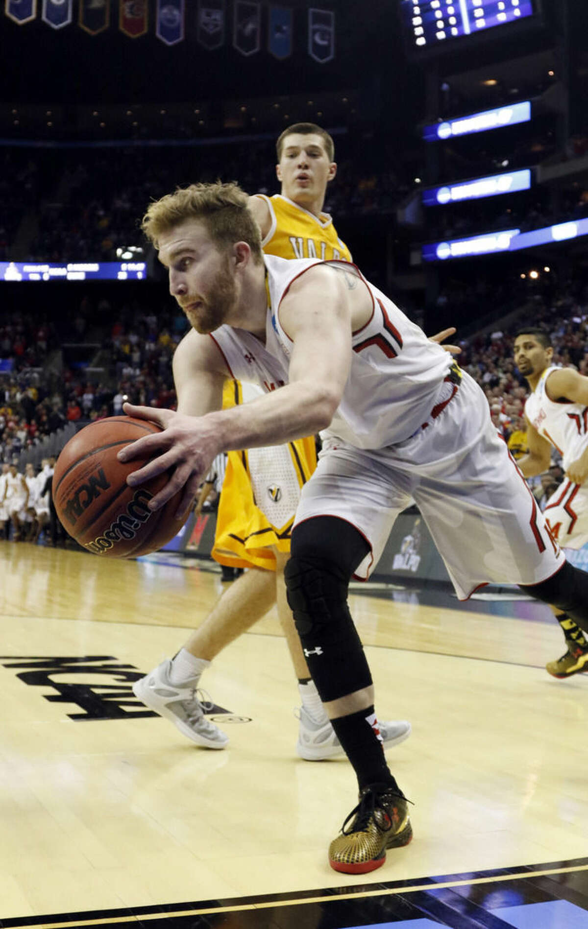 Maryland's Evan Smotrycz keeps the ball from falling out of bounds in the final seconds of a 65-62 win over Valparaiso in an NCAA tournament college basketball game in the Round of 64 in Columbus, Ohio, Friday, March 20, 2015. (AP Photo/Paul Vernon)