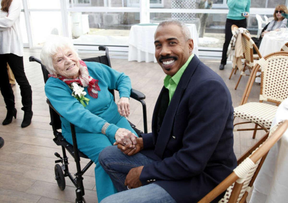 Vivian Salvatore, Former Miss Roton Point (1931), speaks with friend & neighbor Gardner Stevens during her 100th birthday celebration at the Norwalk Inn Sunday afternoon. Hour Photo / Danielle Calloway