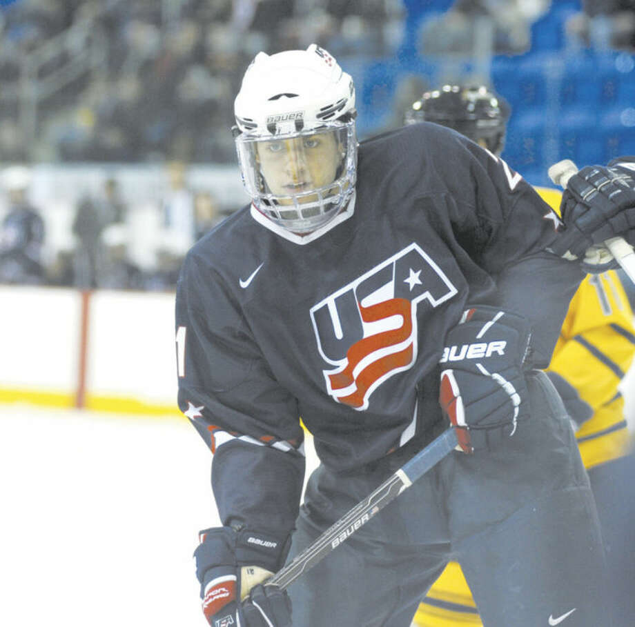 File photo by John NashStamford's Ryan Haggerty, seen here playing against Quinnipiac while suiting up for the Team USA?U-18 Developmental team, is now heading to the college ranks for real -- at RPI.