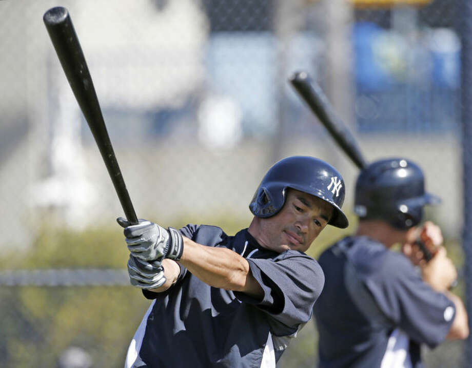 New York Yankees Ichiro Suzuki swings a bat during batting practice before a spring exhibition baseball game against the Atlanta Braves in Tampa, Fla., Sunday, March 16, 2014. (AP Photo/Kathy Willens)