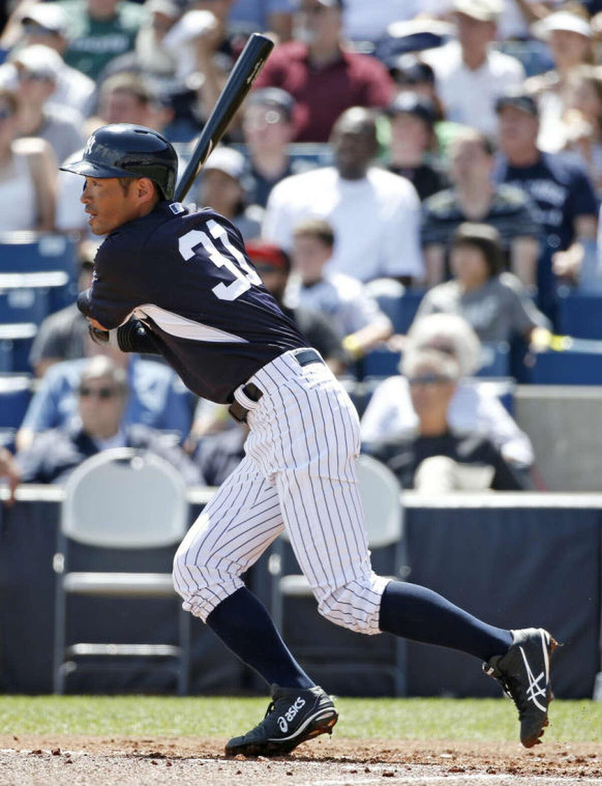 New York Yankees' Ichiro Suzuki hits a first-inning double off Atlanta Braves starting pitcher Julio Teheran in a spring exhibition baseball game in Tampa, Fla., Sunday, March 16, 2014. (AP Photo/Kathy Willens)