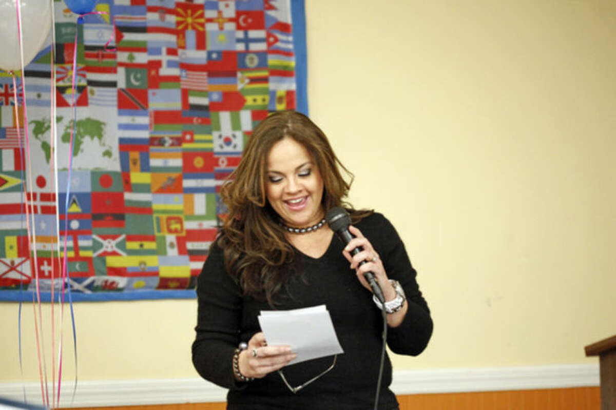 """Gabriela Pena Perelli speaks at a Latino community forum, """"Latinos Unidos de Connecticut,"""" urging the community to """"stand united for a cause,"""" at the South Norwalk Community Center Sunday afternoon. Hour Photo / Danielle Calloway"""
