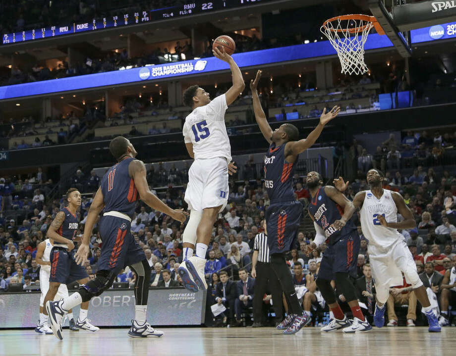 Duke's Jahlil Okafor (15) shoots against Robert Morris during the first half of an NCAA tournament college basketball game in the Round of 64 in Charlotte, N.C., Friday, March 20, 2015. (AP Photo/Gerald Herbert)