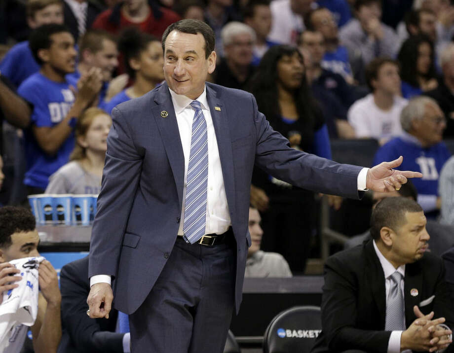 Duke head coach Mike Krzyzewski directs his team against Robert Morris during the first half of an NCAA tournament college basketball game in the Round of 64 in Charlotte, N.C., Friday, March 20, 2015. (AP Photo/Nell Redmond)
