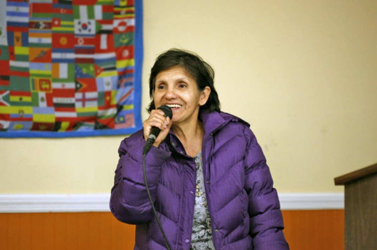 """Asuncion A. Molina Arbiet speaks at a Latino community forum, """"Latinos Unidos de Connecticut,"""" urging the community to """"stand united for a cause,"""" at the South Norwalk Community Center Sunday afternoon. Hour Photo / Danielle Calloway"""