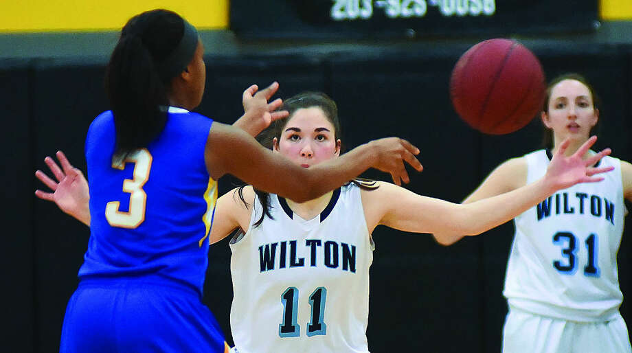 Action from Monday's CIAC Class LL girls basketball semifinals between Wilton and Mercy. (Hour photo/John Nash)