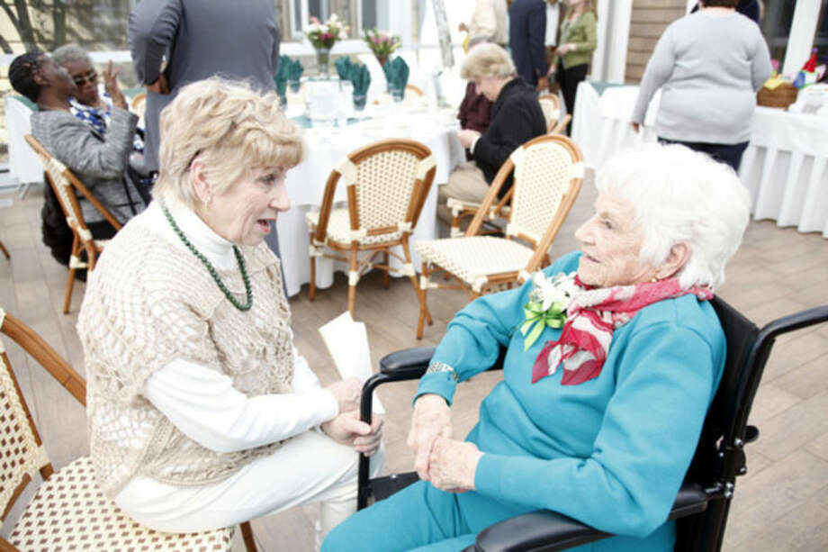 Jeanne Savastano talks with her mother Vivian Salvatore, Former Miss Roton Point (1931), during her 100th birthday celebration at the Norwalk Inn Sunday afternoon.Hour Photo / Danielle Calloway