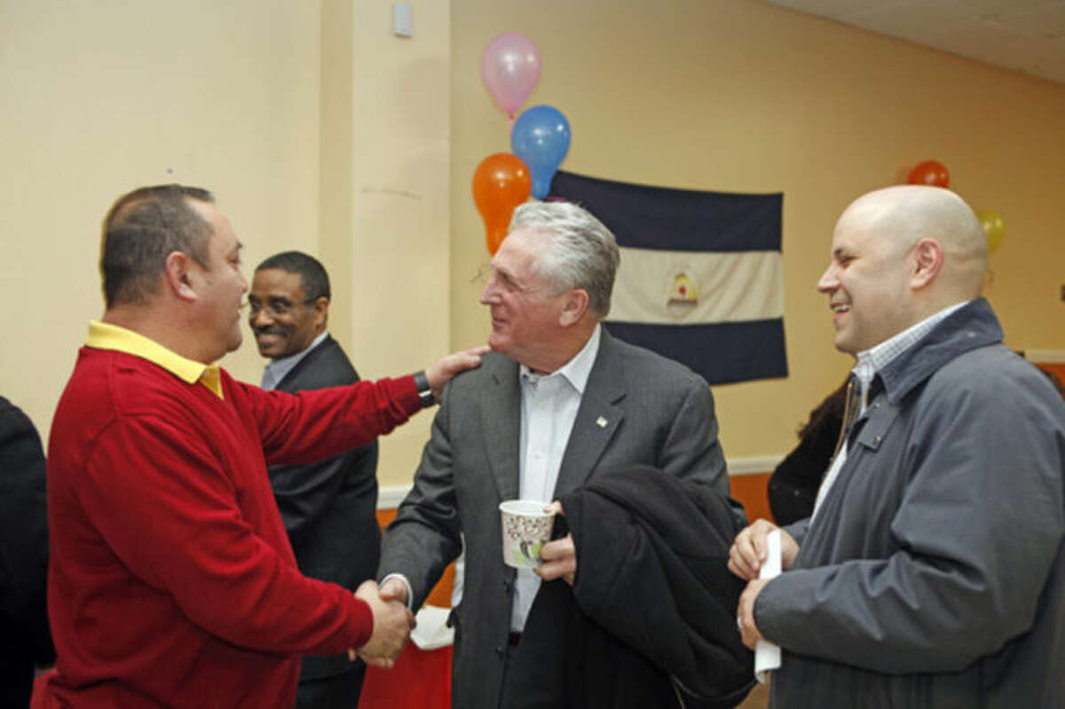 """Mayor Harry Rilling speaks wih George Caceres and Felix Serrano at a Latino community forum, """"Latinos Unidos de Connecticut,"""" urging the community to """"stand united for a cause,"""" at the South Norwalk Community Center Sunday afternoon. Hour Photo / Danielle Calloway"""