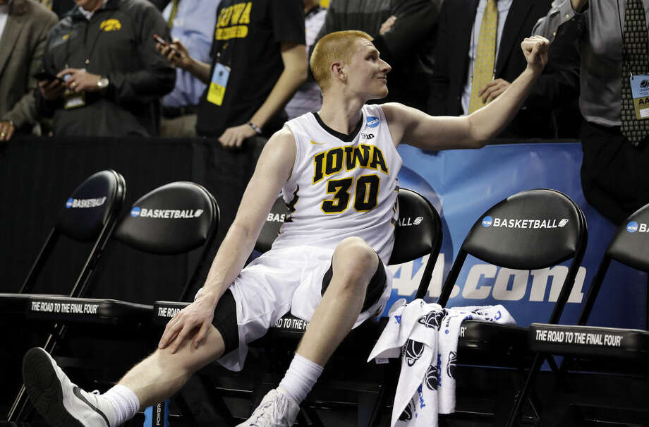 Iowa's Aaron White turns to get congratulations as he sits in the bench late in the second half of an NCAA tournament college basketball game in the Round of 64 in Seattle, Friday, March 20, 2015. White led all scorers with 26 points and Iowa won 83-52. (AP Photo/Elaine Thompson)