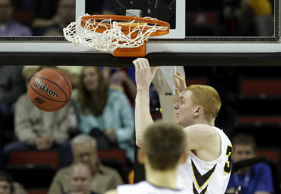 Iowa's Aaron White dunks against Davidson during the first half of an NCAA tournament college basketball game in the Round of 64 in Seattle, Friday, March 20, 2015. (AP Photo/Elaine Thompson)