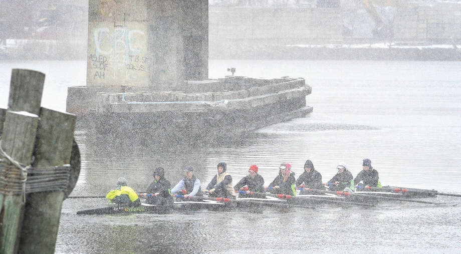 Hour Photo/Alex von KleydorffRowers with The Connecticut Boat Club make their way up the Norwalk River on Friday, with water temperatures in the 30's and snow falling steadily on the first day of spring.