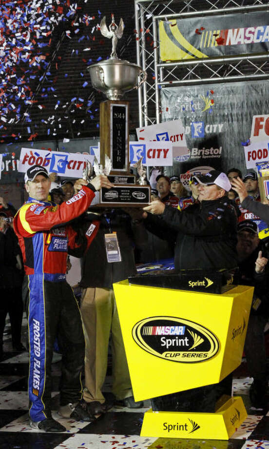 Driver Carl Edwards (99) celebrates in victory lane with his trophy after winning the NASCAR Sprint Cup series auto race at Bristol Motor Speedway, Sunday, March 16, 2014, in Bristol, Tenn. (AP Photo/Wade Payne)