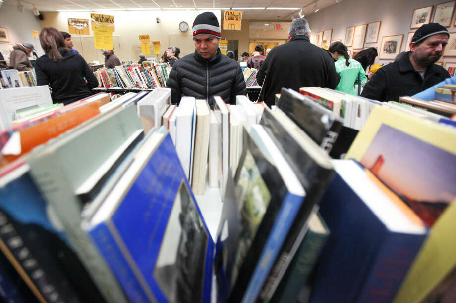 Hour photo/Chris Palermo. Westport residents browse through the books at the Westport Public Library book sale Sunday morning.