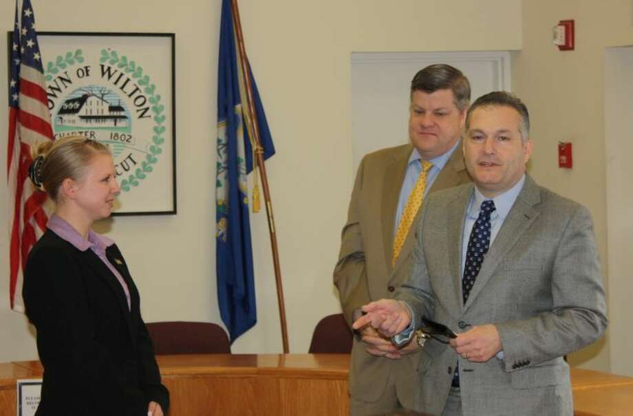Officer Elise Holland is sworn in as the newest member of the Wilton Police Department by Chief Michael Lombardo, as Commissioner Chris Weldon looks on.