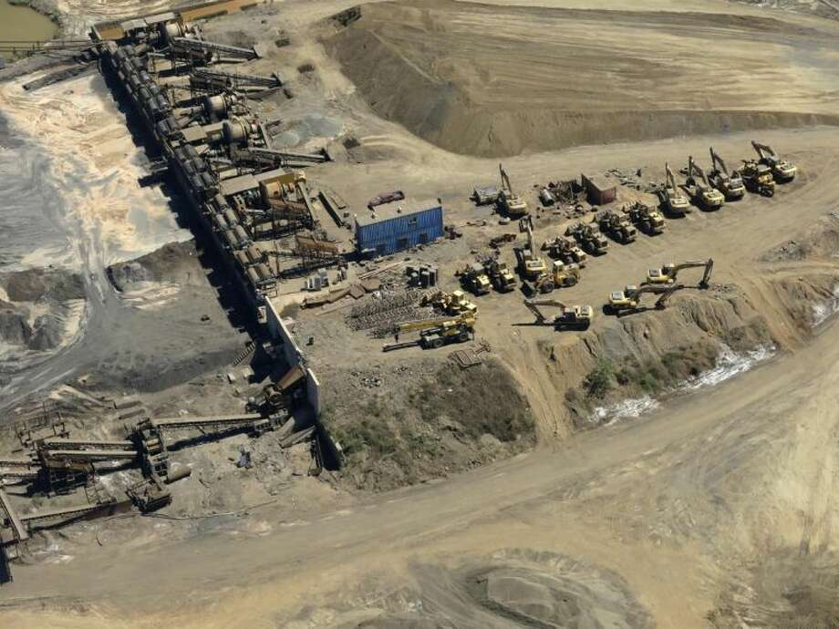 This March 12, 2014 photo shows a confiscated iron ore mining operation near the Pacific port of Lazaro Cardenas, Mexico. The Knights Templar and its predecessor, La Familia, started out as major producers and transporters of methamphetamine, but today, the cartel counts illegal mining, logging and extortion as its biggest moneymakers, according to Alfredo Castillo, the government's special envoy sent to bring the violent Michoacan state, controlled by the Knights Templar for the last several years, under the rule of law. (AP Photo/Eduardo Castillo)