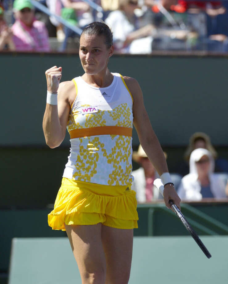 Flavia Pennetta, of Italy, celebrates after winning the first set of her finals match to Agnieszka Radwanska, of Poland, at the BNP Paribas Open tennis tournament, Sunday, March 16, 2014, in Indian Wells, Calif. (AP Photo/Mark J. Terrill)