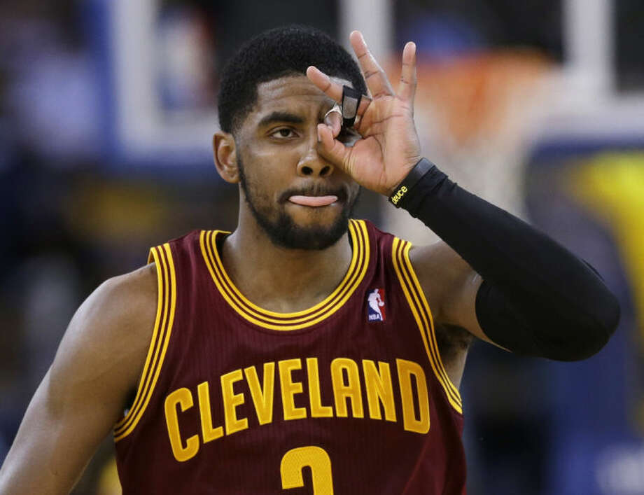Cleveland Cavaliers guard Kyrie Irving celebrates after making a 3-point basket against the Golden State Warriors during the second half of an NBA basketball game Friday, March 14, 2014, in Oakland, Calif. Cleveland won 103-94. (AP Photo/Marcio Jose Sanchez)