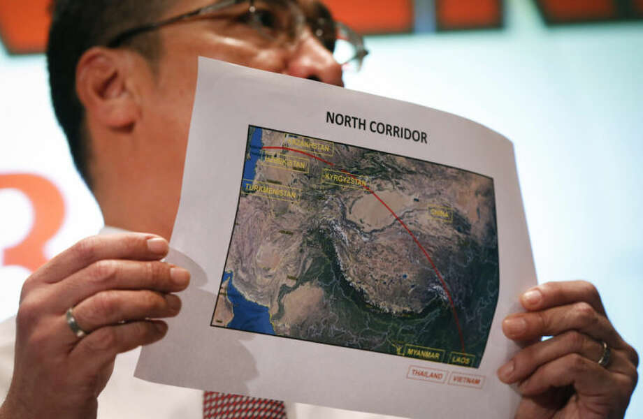 Malaysia's acting Transport Minister Hishamuddin Hussein shows the map of northern search corridor during a press conference at a hotel next to the Kuala Lumpur International Airport, in Sepang, Malaysia, Monday, March 17, 2014. Twenty-six countries are involved in the massive international search for the Malaysia Airlines jetliner that disappeared on March 8 with 239 people aboard. They include not just military assets on land, at sea and in the air, but also investigators and the specific support and assistance requested by Malaysia, such as radar and satellite information. (AP Photo/Vincent Thian)
