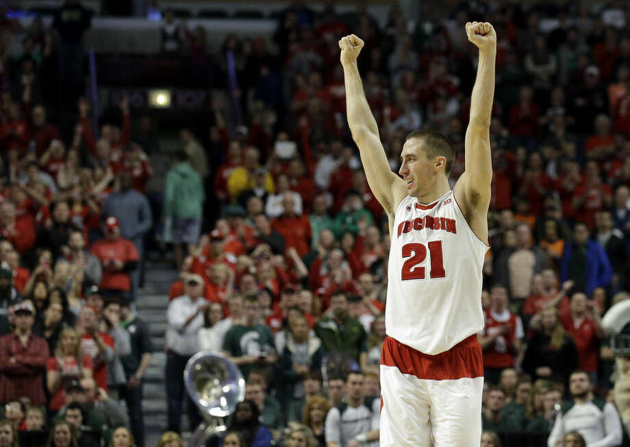 Wisconsin's Josh Gasser (21) celebrates in the second half of an NCAA college basketball game in the championship of the Big Ten Conference tournament in Chicago, Sunday, March 15, 2015. Wisconsin defeated Michigan State 80-69 in overtime. (AP Photo/Nam Y. Huh)