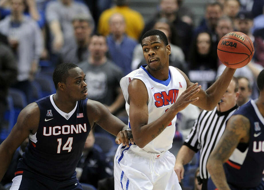 SMU's Yanick Moreira, right, is guarded by Connecticut's Rakim Lubin during the first half of an NCAA college basketball game in the finals of the American Athletic Conference tournament in Hartford, Conn., on Sunday, March 15, 2015. (AP Photo/Fred Beckham)