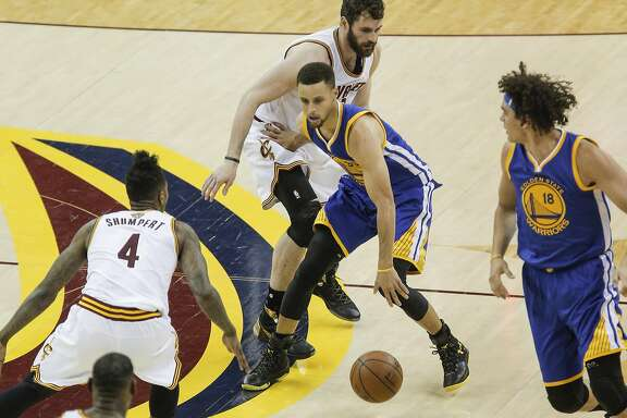 Golden State Warriors' Stephen Curry tries to get away from Cleveland Cavaliers' Kevin Love and Iman Shumpert in the third quarter during Game 4 of the NBA Finals at The Quicken Loans Arena on Friday, June 10, 2016 in Cleveland, Ohio.