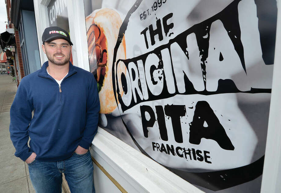 Owner Matt Stockel stands in front of his new sandwich shop Pita Pit, which is set to open in April.